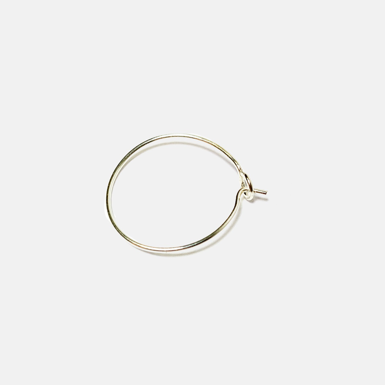 The NEVER WITHOUT earring - ORO BIANCO